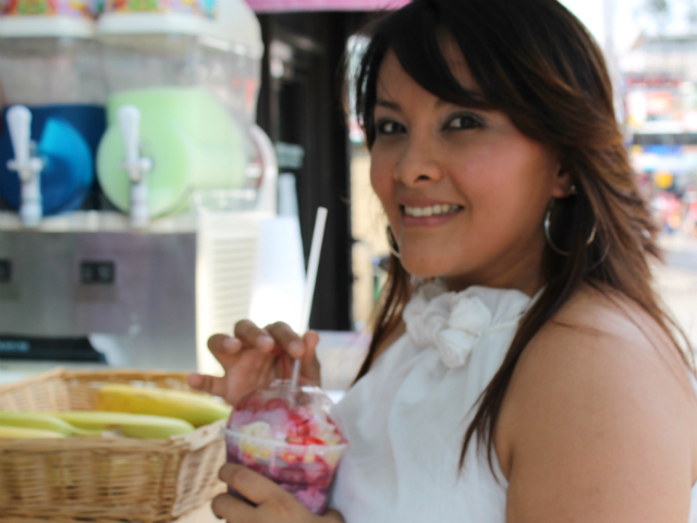 Veronica Ortega, 24, of East Elmhurst slurps down a refreshing Cholada.
