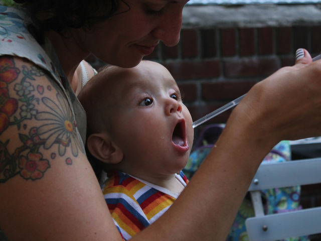 Heather Young cools off her nephew Lucas Carmona Young on the seating deck at Maggie Brown in Fort Greene.