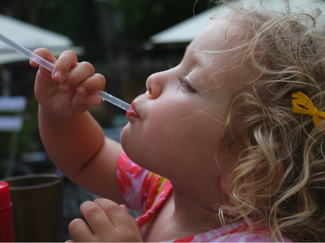 Sofia Carmona Young takes a sip of a cool drink on the deck at Maggie Brown in Fort Greene.