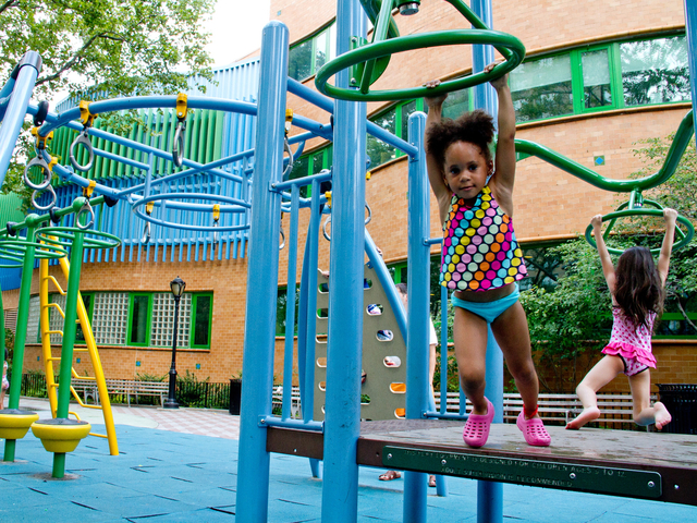 Kids wore bathing suits while playing at the Dekovats Playground while trying to cool off as the mercury hit 100 on July 18, 2012.