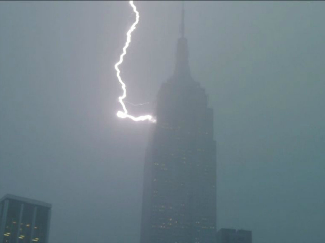 Lightning strikes the Empire State Building during a fast moving, violent storm on July 18, 2012.