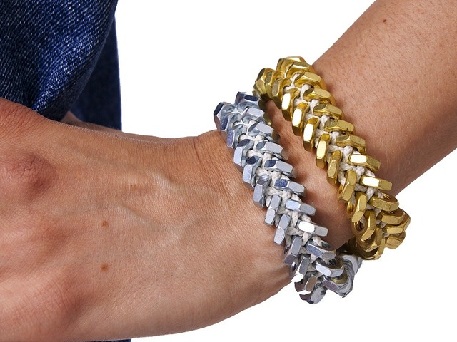 Designs come in either brass or silver toned hex nuts woven together with rope.