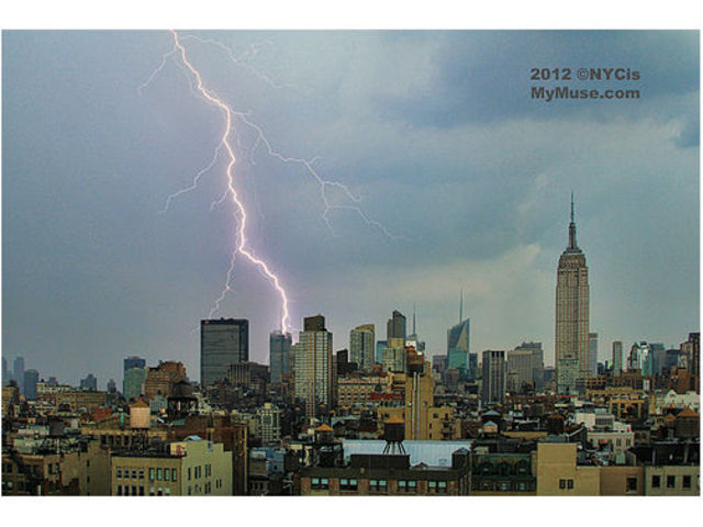 "Twitter use NYC is my Muse (@NYCismyMuse) posted this photo with the comment, "" Monster Storm! Huge Lightning Flash on midtown NYC skyline behind NY Times. Also pictured, Empire State Building, Bank of America Tower, 1 Penn Plaza during a huge late afternoon hail storm that hit NYC."""