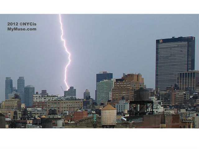 """Zzzzzzzzt! Looks like violent lightning storm nails NYC west side construction project. You may not be able to tell, but it looks like the entire frame outline of the building is glowing, as is the tip of the crane!"" -- @NYCismyMuse"
