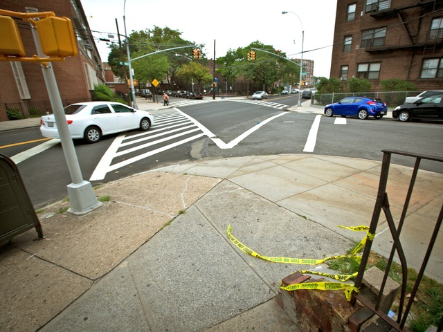 Yellow tape marks the scene in Sunnyside where a 37-year-old bicyclist was struck and killed by a hit-and-run driver on July 19, 2012.
