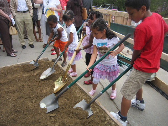 Kids who will benefit from the project also tossed some dirt to help break ground.