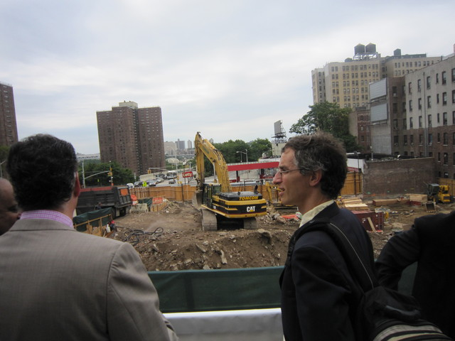 Visitors look at the site of the future project.