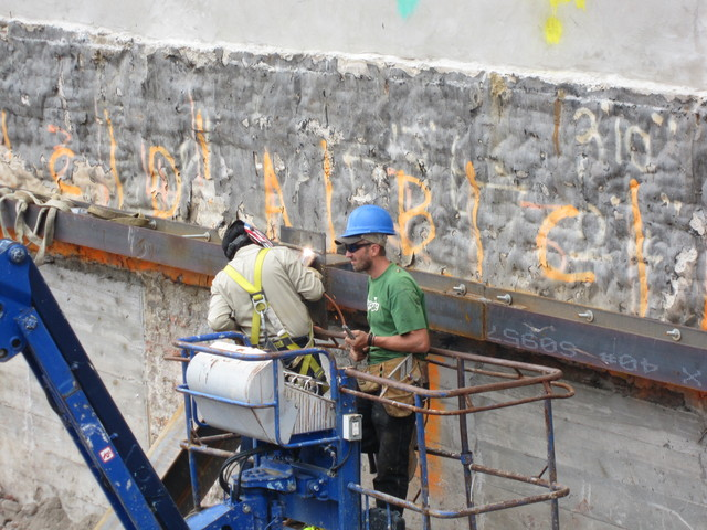 Workers weld on the site of the project.