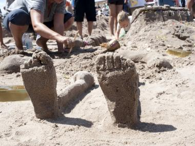 Feet protrude from a first prize winning sculpture on July 21, 2012 in the Coney Island Sand Sculpting contest.