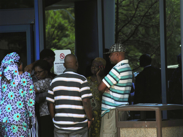 Outside Jamaica Hospital, friends and relatives of the victims consoled one another on July 22, 2012.