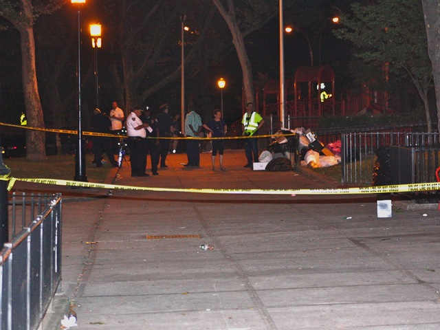 Yellow police tape ringed the scene of the shooting Sunday, July 22, 2012.