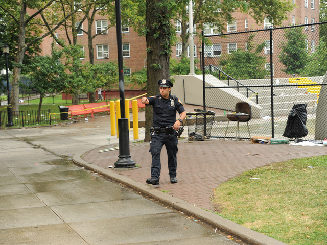 A Police Officer at the scene on East 165th Street where 4yr old Lloyd Morgan was killed on Monday July 23rd, 2012.