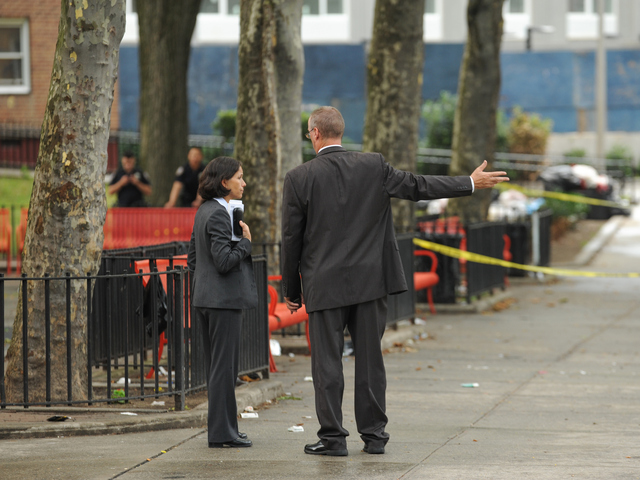 Detectives at the crime scene outside of 735 East 165th Street where a 4yr old boy was killed on Monday July 23rd, 2012.