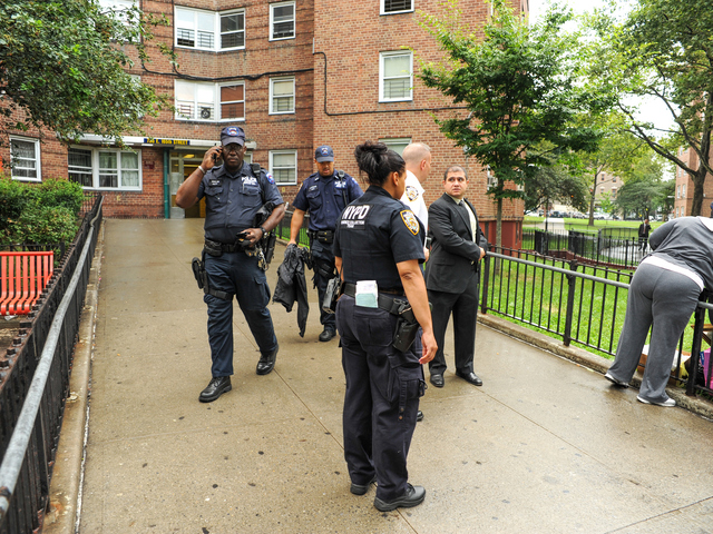 NYPD Evidence Collection Team outside of 735 East 165th Street in the Bronx where 4yr old Lloyd Morgan was killed late Sunday night on Monday July 23rd, 2012.