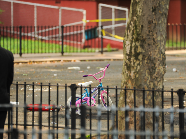 A bicycle can be seen on the playground where 4yr old Lloyd Morgan was shot and killed late Sunday night on Monday July 23rd, 2012.