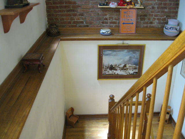 Staircase to downstairs bedrooms at 375 Lincoln Pl.