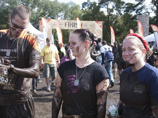 Victorious, mud-covered runners at the Down & Dirty National Mud and Obstacle Series.