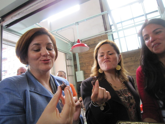 Council speaker Christine Quinn, East Harlem Councilwoman Melissa Mark-Viverito and Christina Bhan, co-owner of My Sweet Brigadeiro, try one of the Brazilian sweets.