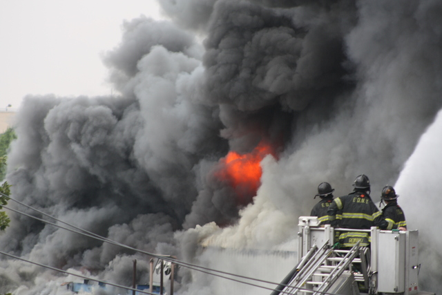 Firefighters battled a three-alarm blaze at 3250 Fulton St.