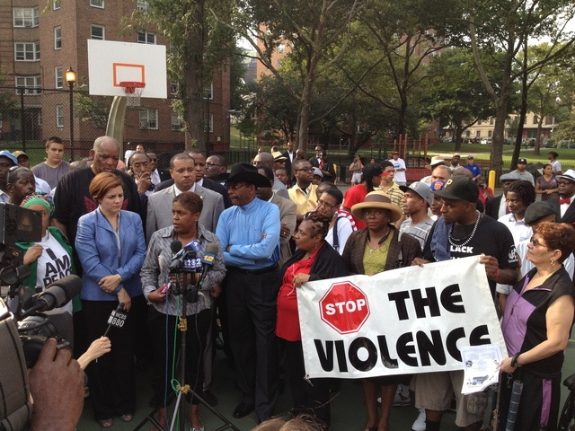 City Councilwoman Diane Foster spoke out on Monday, July 23, 2012 against violence at the scene where Lloyd Morgan was killed. City Council Speaker Christine Quinn stands to her left.