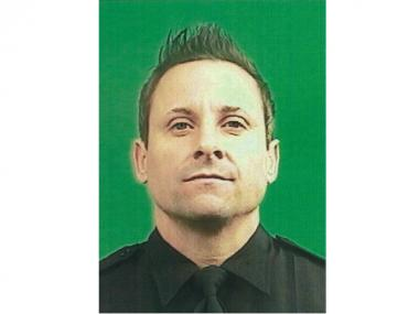 Emergency Unit Service Detective Anthony Borowiec climbed over the side of the Verrazano-Narrows Bridge to help rescue an emotional man Monday afternoon, July 23, 2012, the NYPD said.