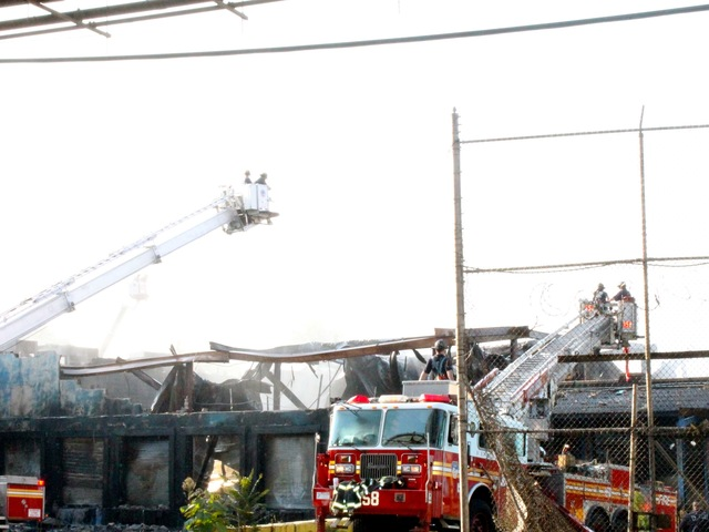 A seven-alarm fire tore through a vacant food factory in Brooklyn on July 23, 2012.