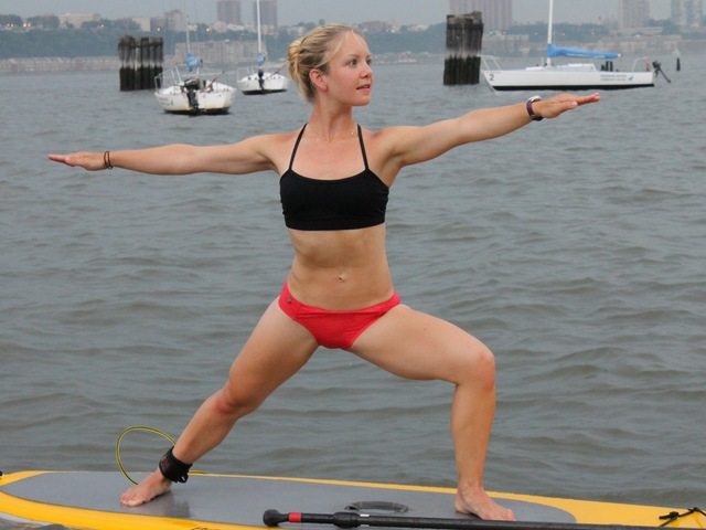 Instructor Shannon MacDowell in a Warrior pose on the paddleboard.
