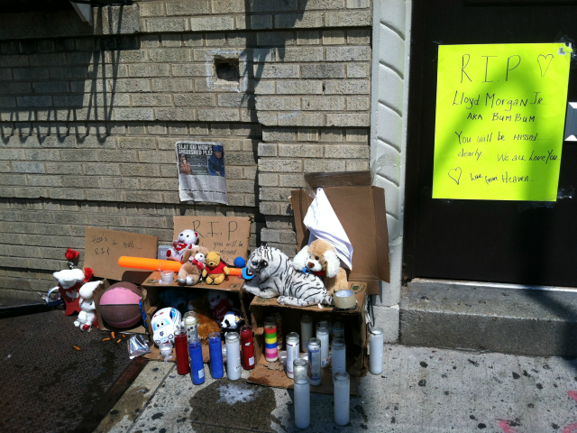 A memorial has been erected outside the home of 4-year-old Lloyd Morgan, who was killed by a stray bullet in The Bronx on Sunday, July 22, 2012.