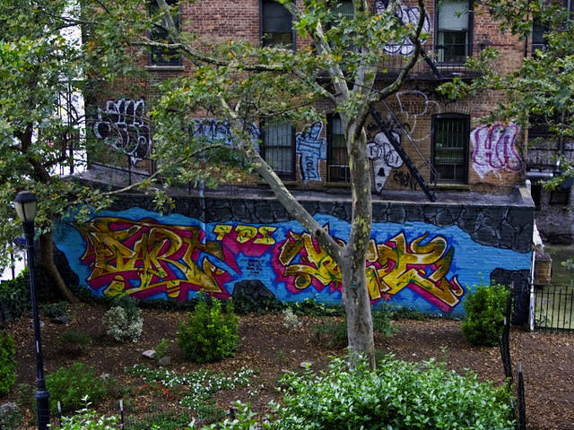 "Although Alan Ket's murals have often been political in nature, his 2012 ""Murderers"" mural resulted in its removal after neighbors complained about its ""violent"" message."