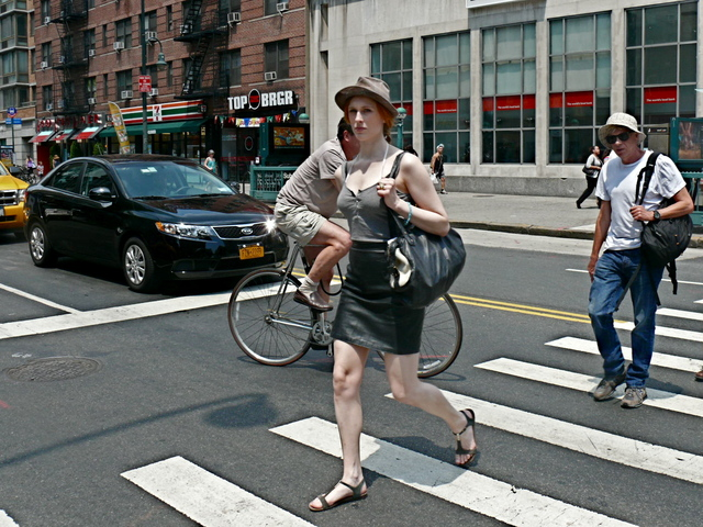 A leather skirt strappy cotton top and t- strap sandals shows the trend of mixing fabric weights and seasons on 14th Street in the West Village.