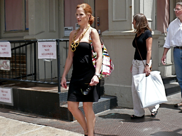 Big bold jewelry  paired with a strapless fitted dress seen on Grand Street in SoHo.