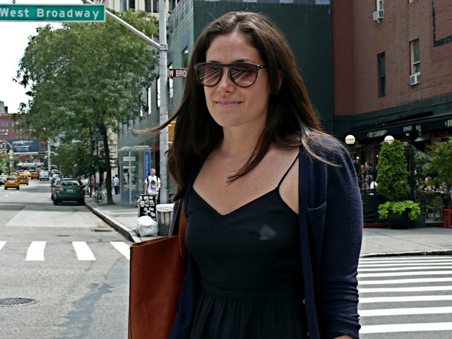Lindsey D. looks chic mixing a light knit  navy cardigan and fitted black cling knit shift in SoHo
