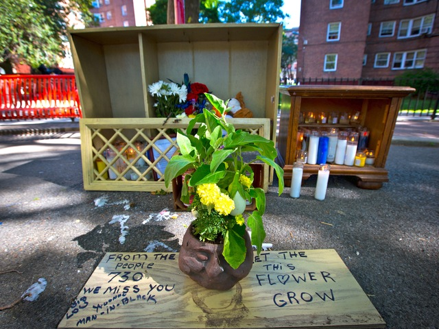 Residents of the Forest Houses in Morrisania set up a makeshift memorial for Lloyd Morgan, 4, who was shot and killed on July 22, 2012.