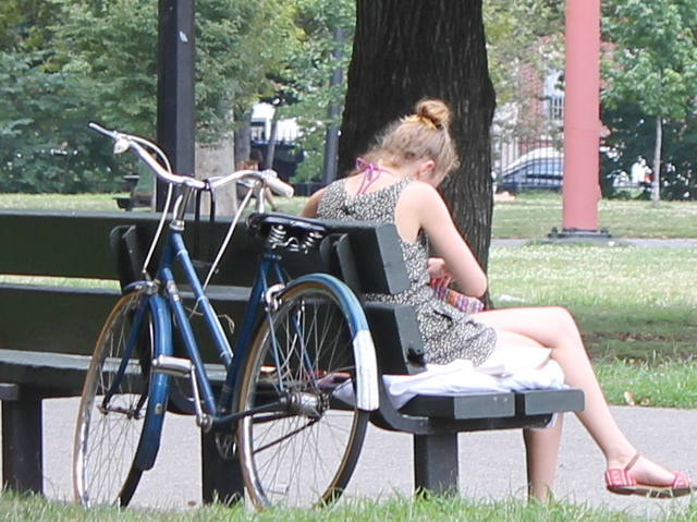 A woman sat by her bike in McCarren Park. Bike thefts have been increasing since spring in Williamsburg and Greenpoint, cops said.