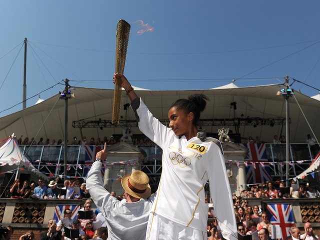 The torch is passed around in anticipation of the 2012 Olympics.
