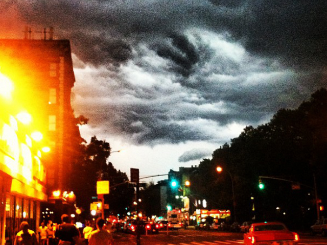 Storm clouds above a New York street July 26, 2012.