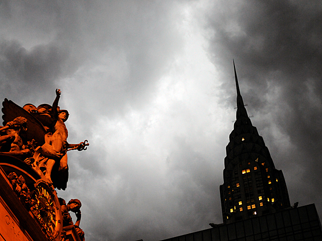 The Chrysler Building's spire stood out against the clouds as a thunderstorm approached July 26, 2012.