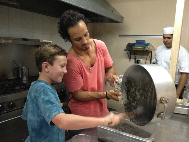 Sam Wohabe cooking in Cozumel, Mexico with La Kinta Chef Kris Wallenta preparing risotto with Huitlacoche.