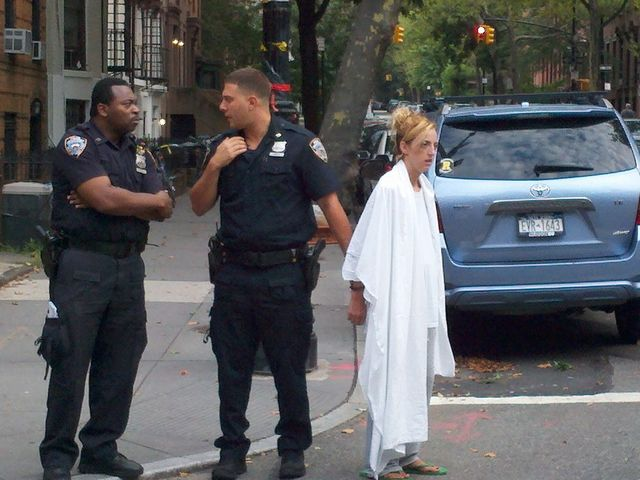 This woman allegedly attacked NY1 reporter Vivian Lee in Cobble Hill Friday morning, July 27, 2012. Police draped a blanket over her shoulders after the incident.