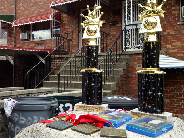 Cassell Brooks, the father of shooting victim Kemar Brooks, displayed the boy's trophies outside of the family's house.