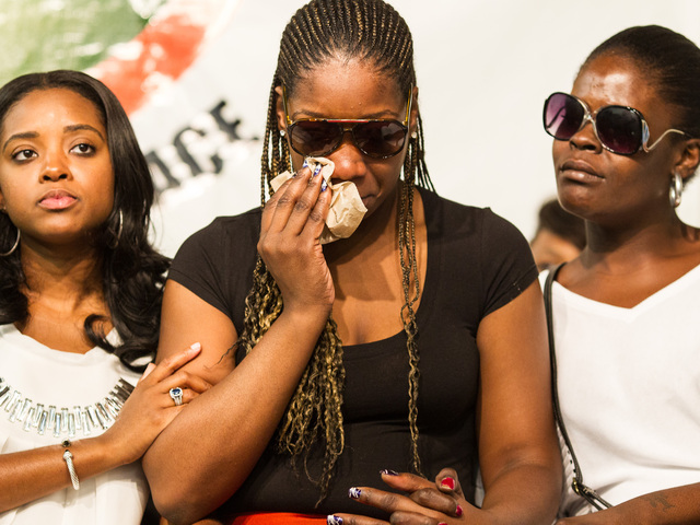 Shianne Normon, the mother of Lloyd Morgan Jr,  the 4-year-old boy who was shot and killed in the Bronx is comforted by friends at the National Action Network Headquarters in Harlem on July 28th, 2012.