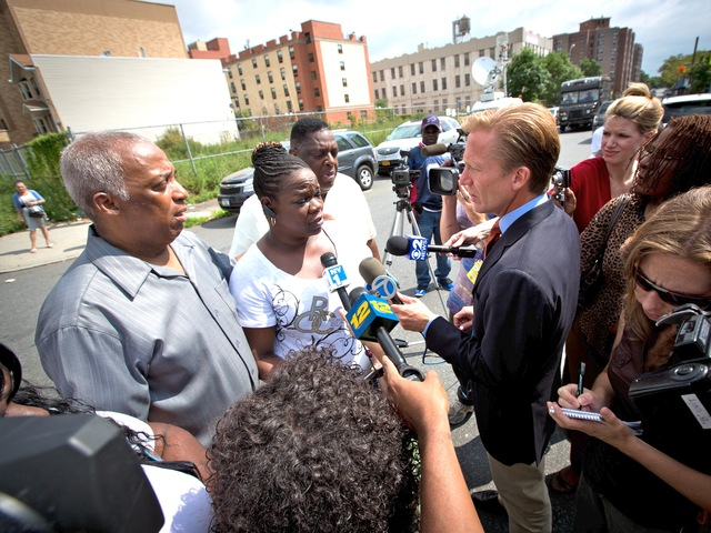 City Councilman Charles Barron meets with reporters a day after a 2-year-old girl was shot in Brownsville.