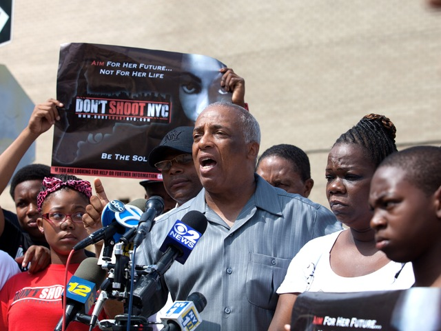 City Councilman Charles Barron, with relatives of a 2-year-old girl who was shot during a drive-by shooting on July 29, 2012, calling for an end to the NYPD's stop-and-frisk policy.