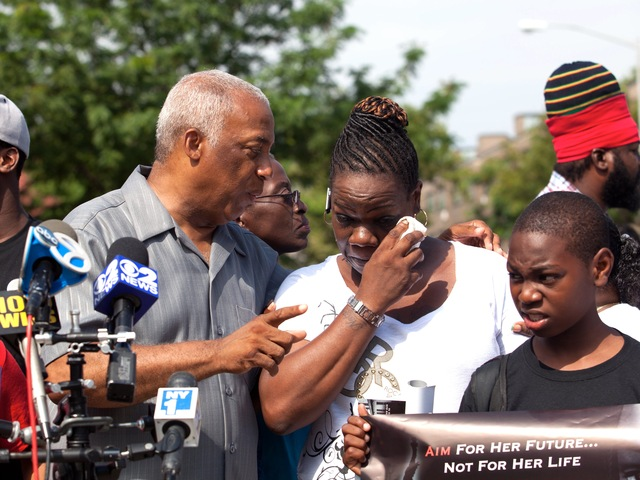 Leteria Hinton, with City Councilman Charles Barron, crying after her granddaughter, Ariyanna Prince, 2, was shot during a drive-by shooting in Brownsville on July 29, 2012.