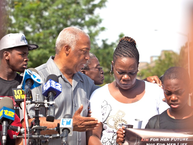 Charles Barron comforts Leteria Hinton, whose granddaughter, Ariyanna Prince, 2, was shot during a drive-by shooting in Brownsville on July 29, 2012.