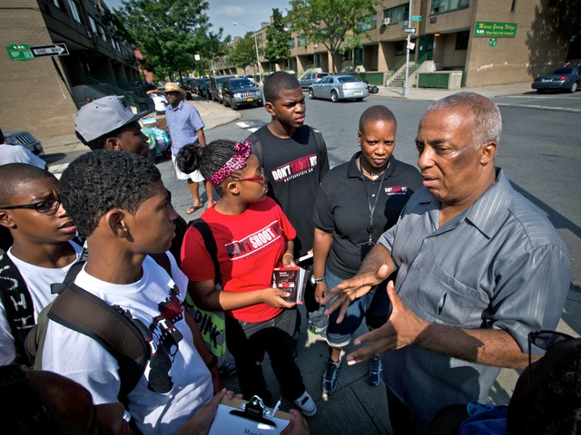 City Councilman Charles Barron talks to young men in Brownsville in the wake of a drive-by shooting on July 29, 2012, that left six people wounded.