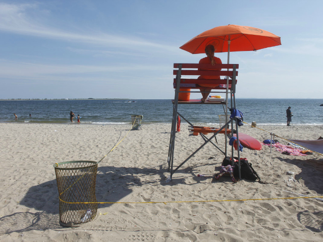 A lifeguard at Manhattan Beach, where a woman was pulled from the water July 30, 2012.