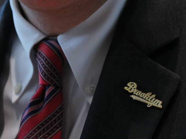 New York State Comptroller Thomas P. DiNapoli wears a Brooklyn pin