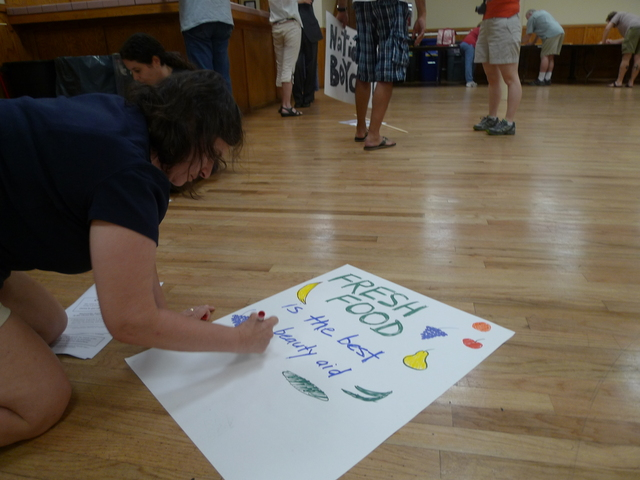 Windsor Terrace residents made signs to bring to an Aug. 1 rally in front of the former Key Food space on Prospect Avenue.