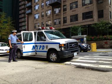 Cops investigated a stabbing at East 40th Street and Second Avenue on Aug. 1, 2012.